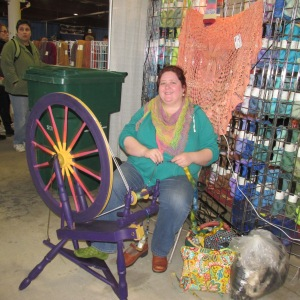 JENNY BANNOCK OF DIVINE BIRD SPINNING ON A COLORFUL CANADIAN PRODUCTION WHEEL