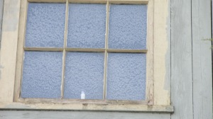 FROST ON THE BARN WINDOW