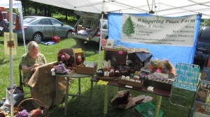THE BOOTH AT THE LAVENDER FEST WITH ME HOOKING ON THE RUG