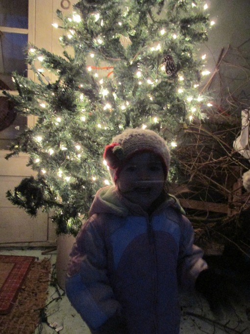 Lil in front of the outside tree